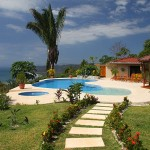 Swimming pool and beautiful gardens of this malpais rental villa