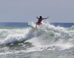 Surfing a wave in Santa Teresa, Costa Rica